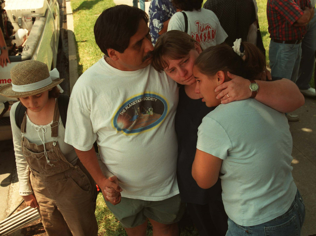 . Arwen, Dan, Lila and Bonnie Vidal wait for sister/daughter Emily at the center where Five victims, three male children and two female adults, were shot at the North Valley Jewish Community Center in Granada Hills, California Tuesday morning, August 10, 1999.   Los Angeles Daily News file photo.