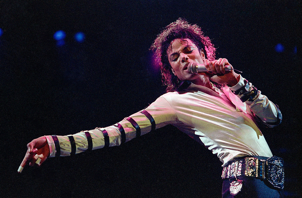 . In this Feb. 24, 1988 file photo, Michael Jackson leans, points and sings, dances and struts during the opening performance of his 13-city U.S. tour, in Kansas City, Mo.  (AP Photo/Cliff Schiappa, File)