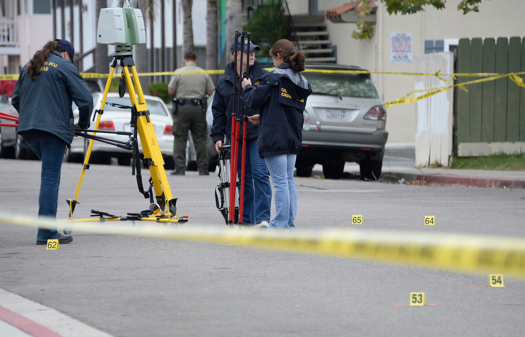 . May 24-,2014. Isla Vista, CA. Investigators at the scene where a drive-by shooting left seven people dead Friday night, including the attacker, and seven others wounded, authorities said Saturday. The gunman got into two gun battles with deputies Friday night in the beachside community of Isla Vista before crashing his black BMW into a parked car. Photo by Gene Blevins/LA Daily News