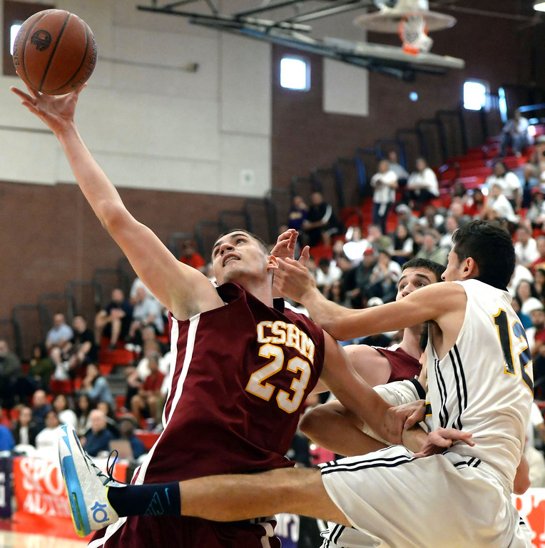 . Cantwell\'s Gligorije Rakocevic (23) rebounds over Bishop Montgomery \'s Blake Miles (12) in the first half of a CIF Southern California Regional Division IV basketball game at Colony High School in Ontario, Calif., on Saturday, March 22, 2014.  (Keith Birmingham Pasadena Star-News)
