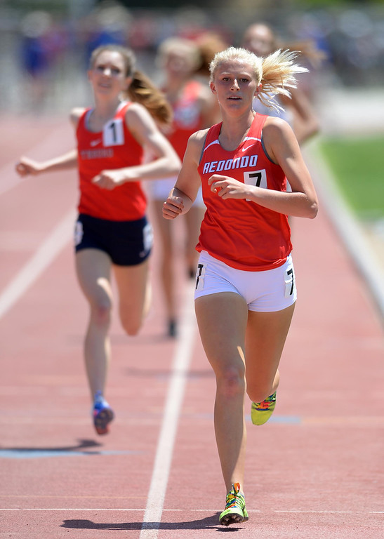 . Redondo Union\'s Kayla Ferron kicks for the win in the 1600 meter Division 2 race of the CIF Southern Section Track and Field Championships Saturday at Mt. SAC. 20130518 Photo by Steve McCrank / Staff Photographer