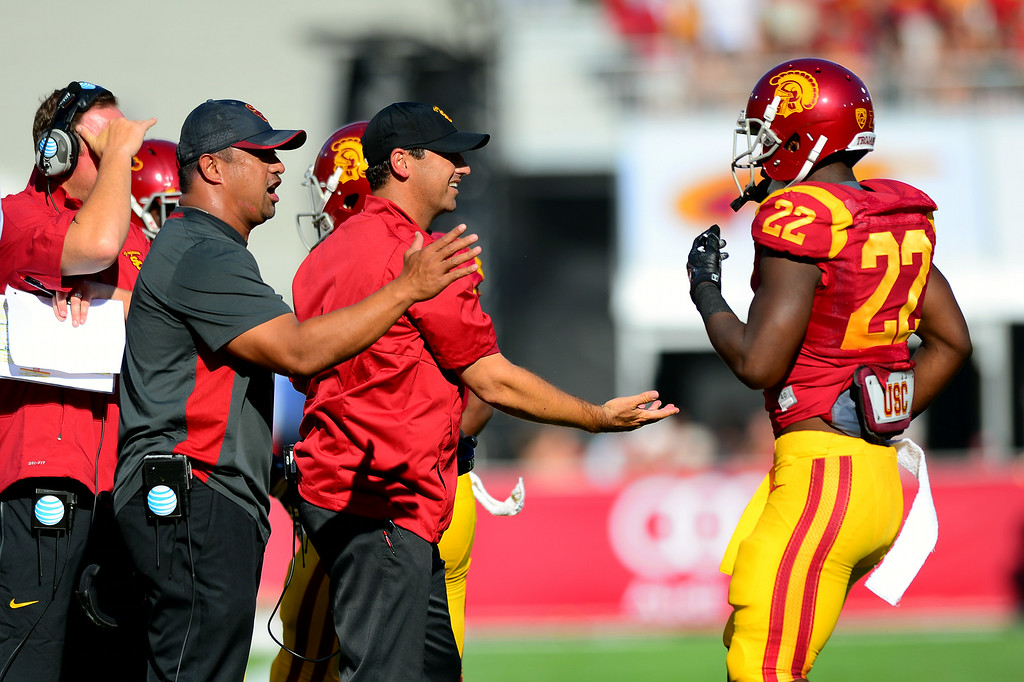 . USC head coach Steve Sarkisian, right, and staff greet Justin Davis after a first-half score, Saturday, August 30, 2014, at the L.A. Memorial Coliseum. (Photo by Michael Owen Baker/Los Angeles Daily News)