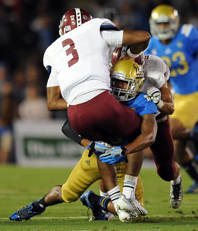 . UCLA safety Randall Goforth (3) tackles New Mexico State cornerback Cameron Fuller (3) for a loss of yards during the first half of their college football game in the Rose Bowl in Pasadena, Calif., on Saturday, Sept. 21, 2013.   (Keith Birmingham Pasadena Star-News)