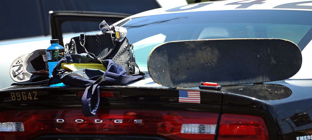 . Items matching the description of a suicidal individual are left on an LAPD car after he was detained and evaluated by LAPD and fire personnel at Canoga Bowl May 30, 2014 in Woodland Hills.  The campus was put on lockdown around noon Friday.(Andy Holzman/Los Angeles Daily News)
