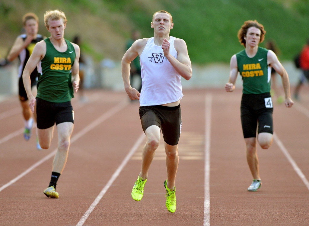 . 05-03-2013-(LANG Staff Photo by Sean Hiller)-  The Bay League track and field finals Friday night at Mira Costa High School. Costa\'s Austin Nuchols wins the boys varsity 400 meter dash.