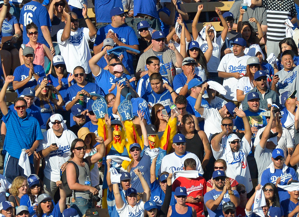 . Fans cheer in the 8th inning. The Dodgers played the Saint Louis Cardinals in game 5 of the National League Championship Series at Dodger Stadium in Los Angeles, CA. 10/15/2013. photo by (John McCoy)/Los Angeles Daily News)