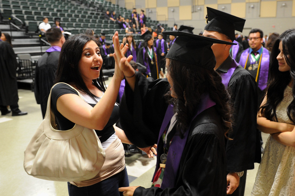 . Zarui Yerkanyan, left, high fives Betzabe Rodriguez before the graduation at Cesar Chavez Learning Academies Social Justice Humanitas Academy in San Fernando, Wednesday, June 5, 2013. (Michael Owen Baker/Staff Photographer)