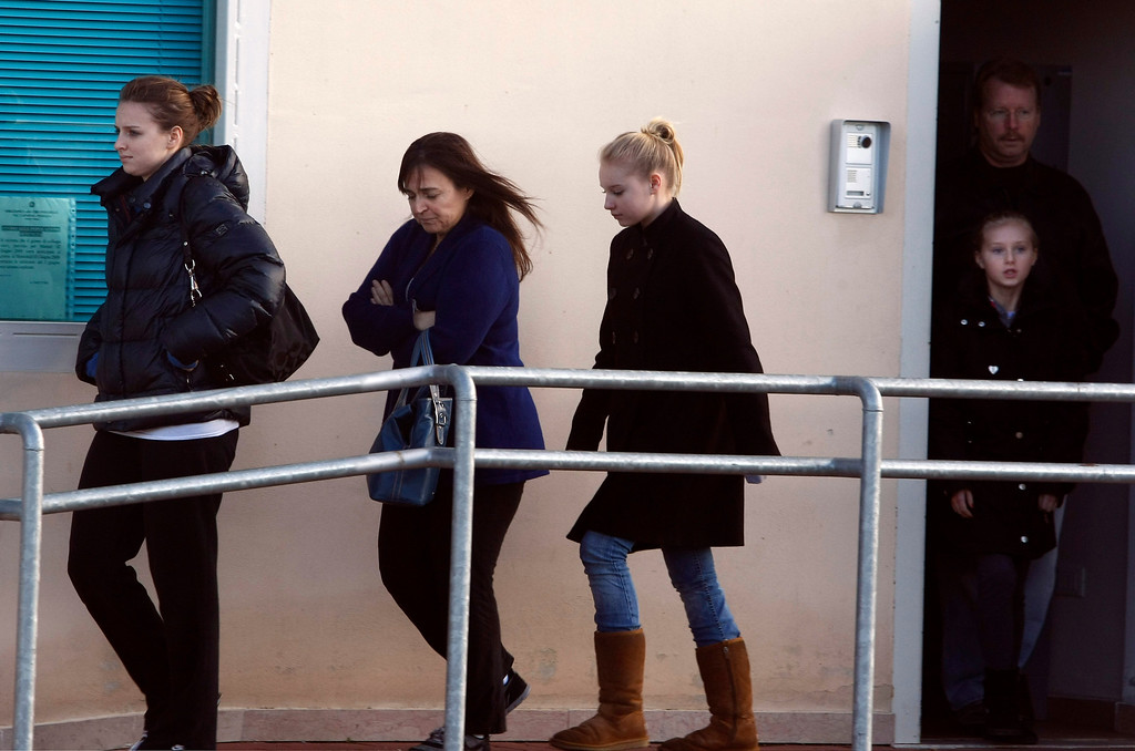 . From left, Amanda Knox\'s sister Deanna, her mother Edda Mellas, her sisters, Ashley and  Delaney, and Amanda\'s father Curt, leave the jail in the outskirts of Perugia, Italy, were Amanda is detained, Saturday, Dec. 5, 2009. A jury in Italy convicted American college student Amanda Knox of murdering her British roommate Meredith Kercher and sentenced her to 26 years in prison. Her Italian ex-boyfriend Raffaele Sollecito was also convicted and sentenced to 25 years. (AP Photo/Pier Paolo Cito)