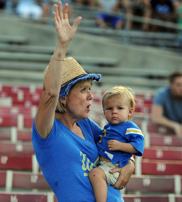 . UCLA fans young and old cheer prior to a college football game between Nevada and UCLA in the Rose Bowl on Saturday, Aug. 31, 2013 in Pasadena, Calif.    (Keith Birmingham Pasadena Star-News)