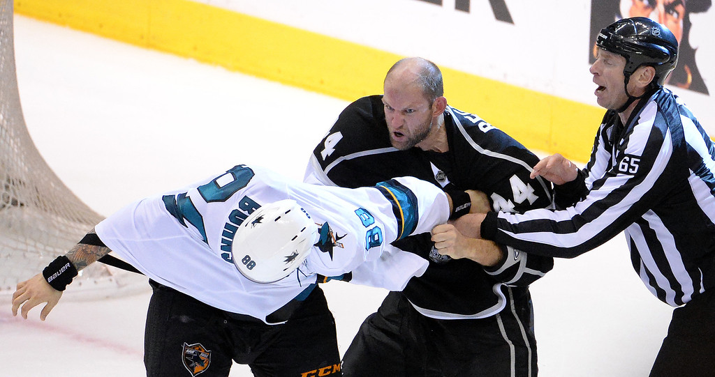 . San Jose Sharks right wing Brent Burns (88) fights with Los Angeles Kings defenseman Robyn Regehr (44) at the end of Game 4 of an NHL hockey first-round playoff series at Staples Center in Los Angeles on Thursday, April, 24  2014. Los Angeles Kings won 6-3. (Keith Birmingham Pasadena Star-News)