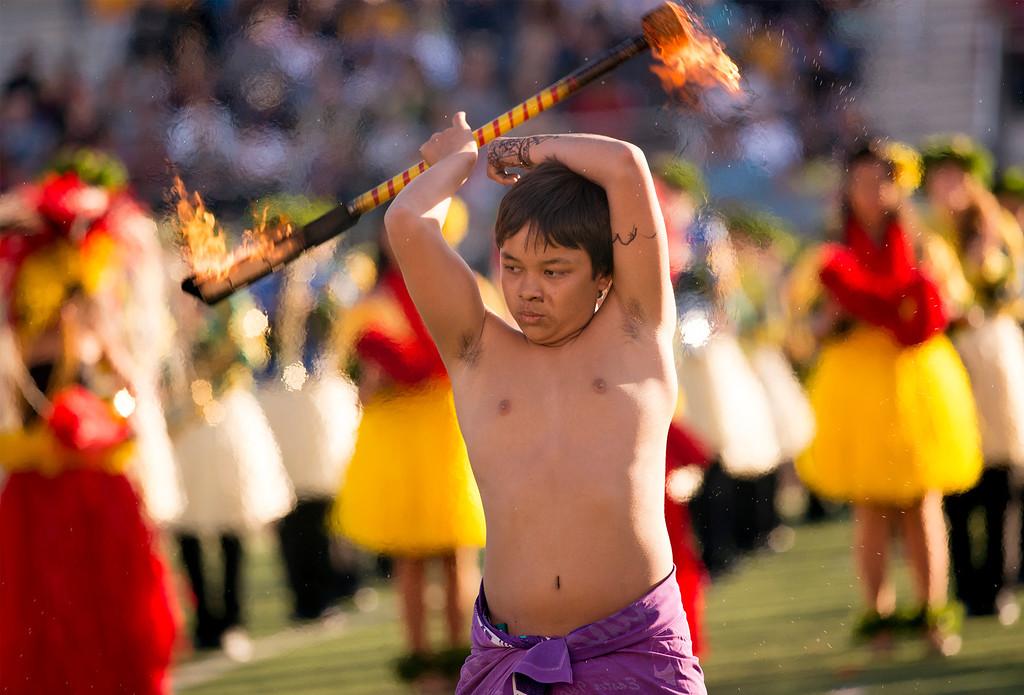 ". Flaming baton twirler T.K. Kaitoku of the Hawaii All-state Marching Band \""Na Koa Ali\'i\"" performs during the Pasadena Tournament of Roses Bandfest I at Pasadena City College Dec. 29, 2013.   (Staff photo by Leo Jarzomb/Pasadena Star-News)"