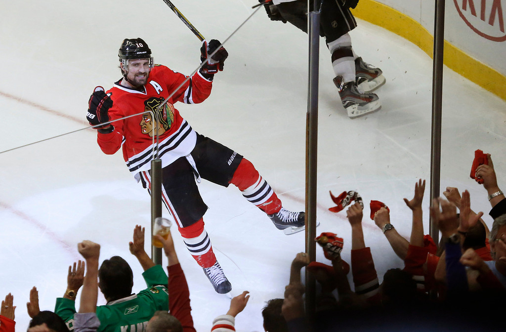 . Chicago Blackhawks center Patrick Sharp (10) reacts after scoring a goal against the Los Angeles Kings during the second period in Game 1 of the NHL hockey Stanley Cup Western Conference finals Saturday, June 1, 2013, in Chicago. (AP Photo/Charles Rex Arbogast)