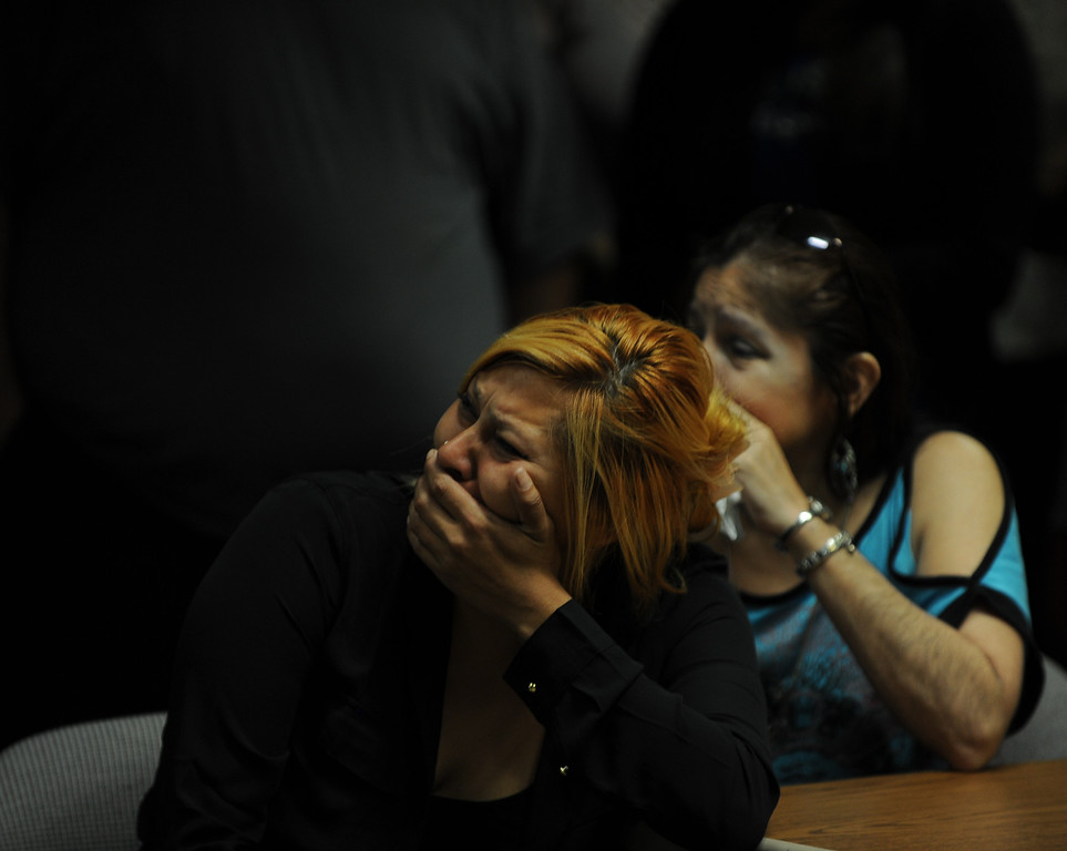 . Janet Cruz,left and Rosie Curonilla, mother of Daniel Olivera breaks down after watching a surveillance footage of her son death during a press conference at the San Bernardino County Sheriff\'s Headquarters Thursday August 22, 2013 in San Bernardino. Daniel Olivera 26, of Hesperia was shot and killed at the AM/PM Arco convenience store on August 11, 2013 in Victorville.LaFonzo Carter/Staff Photographer
