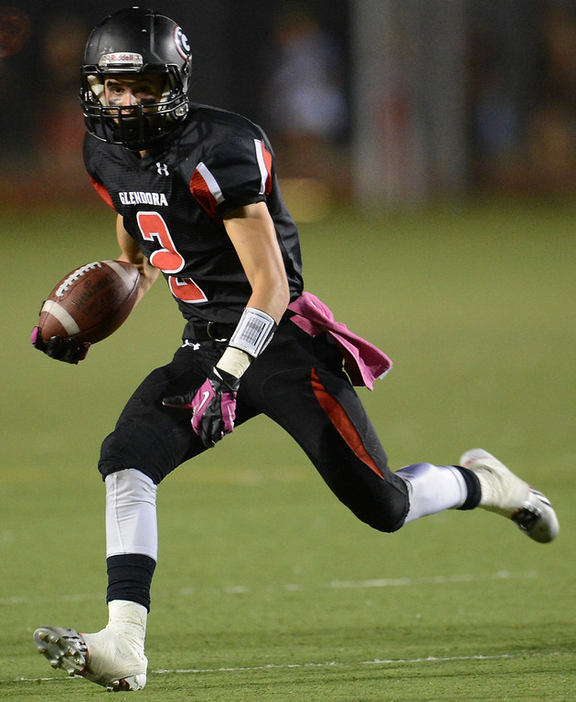 . Glendora\'s Briton Noskoff (2) runs for a first down against Los Osos in the first half of a prep football game at Citrus College in Glendora, Calif., on Thursday, Oct. 31, 2013.    (Keith Birmingham Pasadena Star-News)
