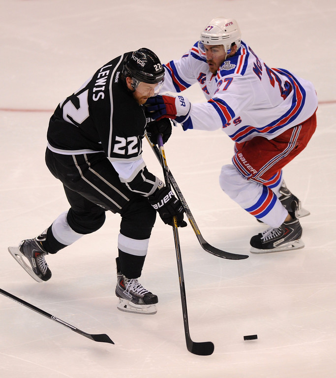 . The Kings\' Trevor Lewis advances the puck against the Rangers\' Ryan McDonagh in the second period of game two of the Stanley Cup Final, Saturday, June 7, 2014, at Staples Center. (Photo by Michael Owen Baker/Los Angeles Daily News)