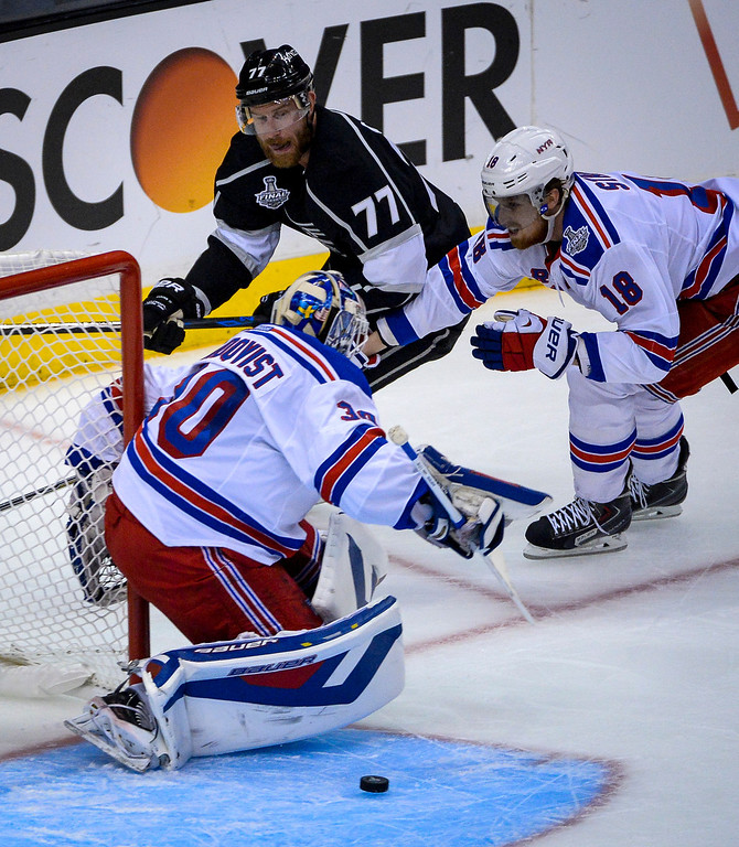 . Kings Jeff Carter can\'t score on this shot as Rangers Henrik Lundqvist and Marc Staal keep the puck out of the net  during first period action at Game 1 of the Stanley cup Finals at Staples Center Wednesday, June 4, 2014 ( Photo by David Crane/Los Angeles Daily News )