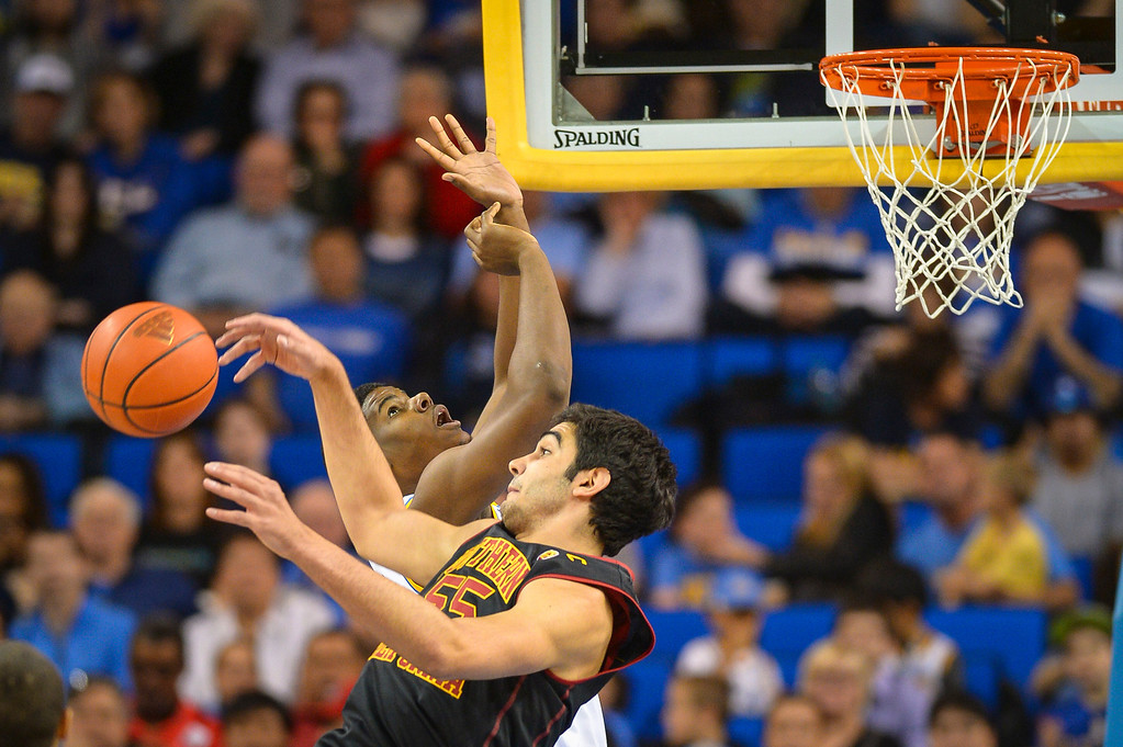 . UCLA�s Tony Parker is fouled by USC�s Omar Oraby during game action at Pauley Pavilion Sunday, December 5, 2014. UCLA  defeated USC 107-73.  Photo by David Crane/Los Angeles Daily News.