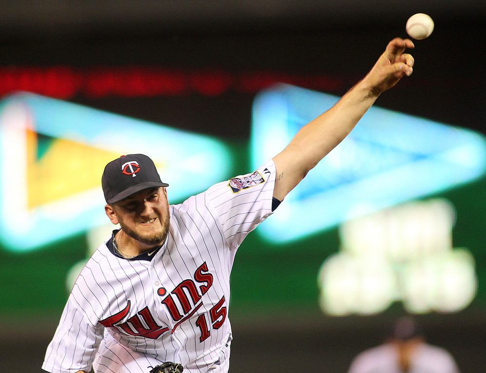 . Minnesota Twins pitcher Glen Perkins throws against the Los Angeles Angels in the 9th inning of their baseball game won by the Twins 6-3 in Minneapolis Monday, Sept. 9, 2013.(AP Photo/Andy Clayton-King)