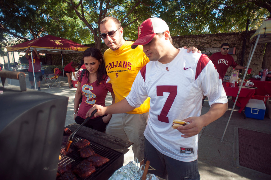 . USC fans Ani Ovasapyan, Studio City, Dan Minor, Burbank, and Ed Melgar, Glendale, before the USC Trojans vs the Washington State Cougars at the Los Angeles Memorial Coliseum  Saturday, September 7, 2013.  (Photo by Hans Gutknecht/Los Angeles Daily News)