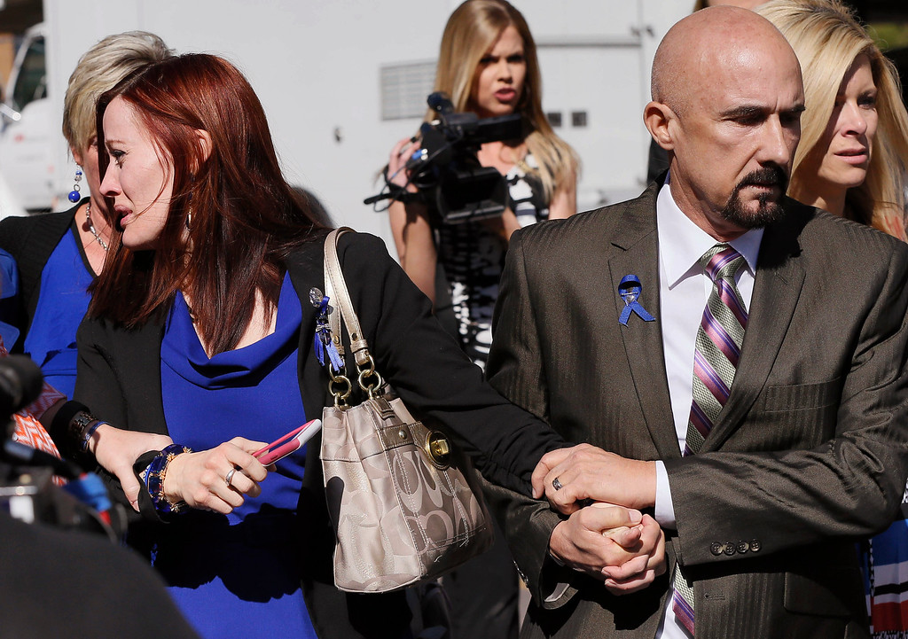 . Tanisha Sorenson, sister of murder victim Travis Alexander, cries as she leaves the court house with family and friends, Thursday, March 5, 2015, in Phoenix. A judge declared a mistrial Thursday in the Jodi Arias sentencing retrial after a jury deadlocked on whether the convicted murderer should be executed or sent to prison for life for the 2008 killing of Alexander.(AP Photo/Matt York)