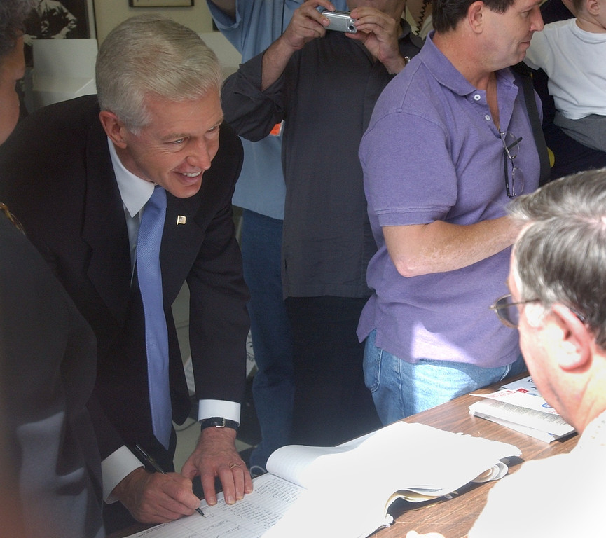 . 10/07/03--WEST HOLLYWOOD--Califonia Gov. Gray Davis signs in at his West Hollywood polling place to cast his vote during the California recall election Tuesday, October 7th, 2003. (Gus Ruelas/LA Daily News)