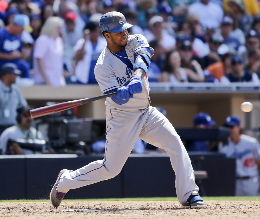 . Los Angeles Dodgers\' Hanley Ramirez drives a home run to right field against the San Diego Padres in the ninth inning of a baseball game won 3-1 by the Dodgers after they hit back-to-back home runs in San Diego, Sunday, June 23, 2013. (AP Photo/Lenny Ignelzi)