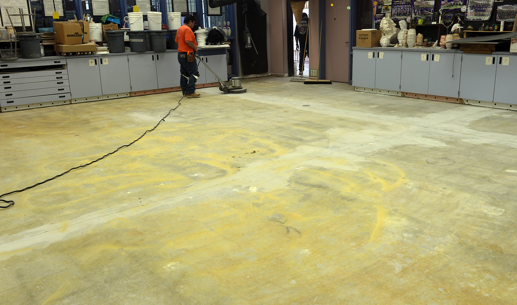 . Contractors work on repairing an earthquake damaged floor in the art studio at Diamond Bar High School on Thursday April 3, 2014. Spring break repairs got more complicated after the recent earthquake damaged areas of the school in addition to planned repairs on campus. (Staff Photo by Keith Durflinger/Whittier Daily News)
