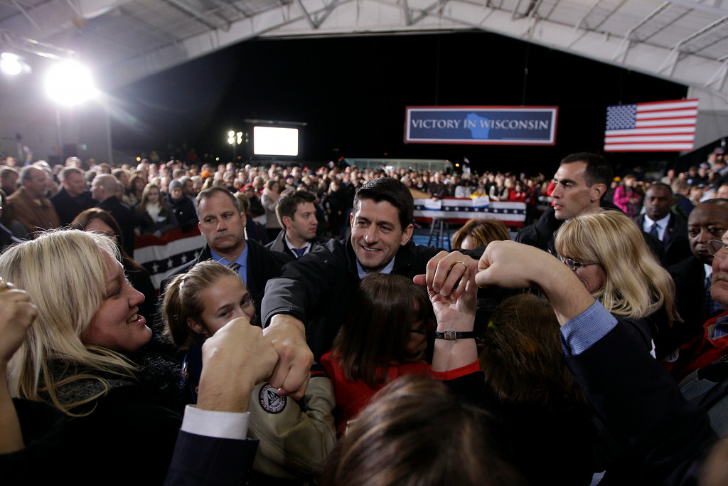 . Republican vice presidential candidate, Rep. Paul Ryan, R-Wis., fist bumps supporters during a campaign rally in Milwaukee, Wis., Monday, Nov. 5, 2012.  (AP Photo/Mary Altaffer)