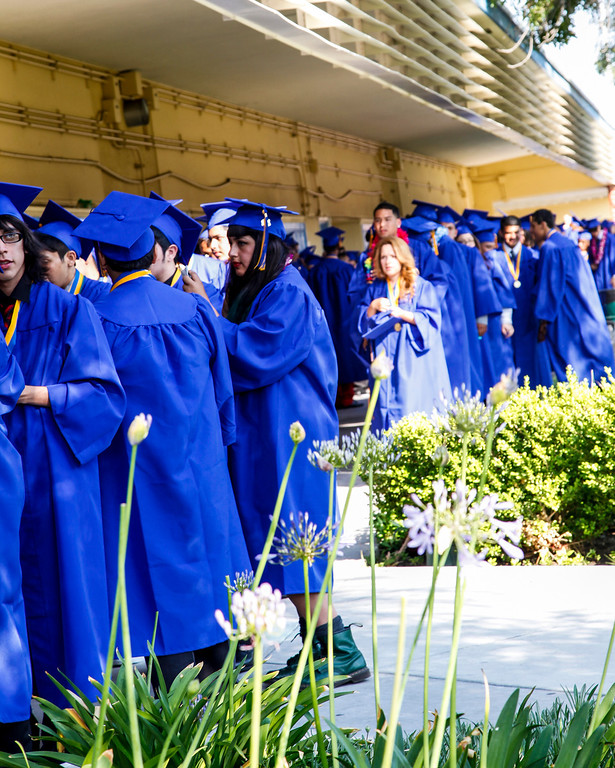 . Last minute scrambling before the graduation ceremony begins at John H Francis Polytechnic High School, Sun Valley, Calif., June 7, 2013. Photo: Lynn Levitt.