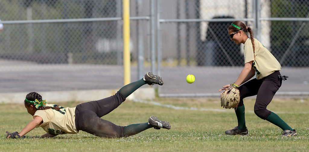 . Narbonne\'s Lovey Corniel and Sabrina Delgado can\'t make the catch against Kennedy High School dueing the City Section Div. I softball semifinal in Granada Hills, Ca May 21, 2013.(Andy Holzman/Staff Photographer)