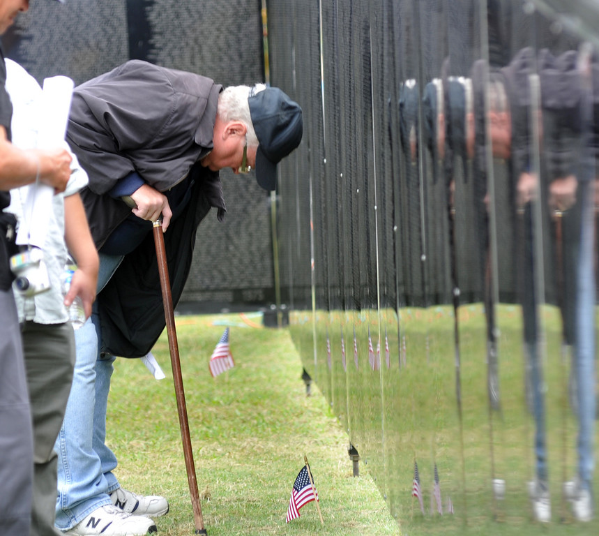 ". Don Siglin, of Brea, looks for names of friends as he visits the ""Wall that Heals\"" traveling replica of the Vietnam Veterans Memorial wall at La Habra High School in La Habra on Thursday July 11, 2013. The wall will be in the stadium until the closing ceremony on Sunday. (SGVN/Staff Photo by Keith Durflinger)"