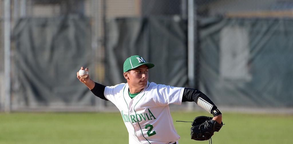 . Monrovia shortstop Nick Carino in the seventh inning of the Arcadia Elk Baseball Tournament against Alhambra at Monrovia High School in Monrovia, Calif., on Thursday, March 13, 2014. Monrovia won 2-0.  (Keith Birmingham Pasadena Star-News)