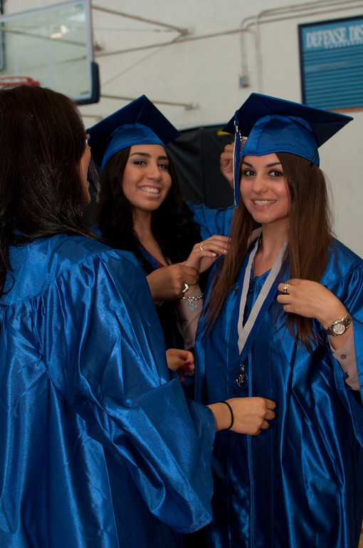 . Reseda seniors gather in the school\'s gym before the graduation ceremony begins.  The Reseda High School graduation class held their commencement in the school football field on Friday,  June 07, 2013 in Reseda, CA.   Photo by Carlos Carpio