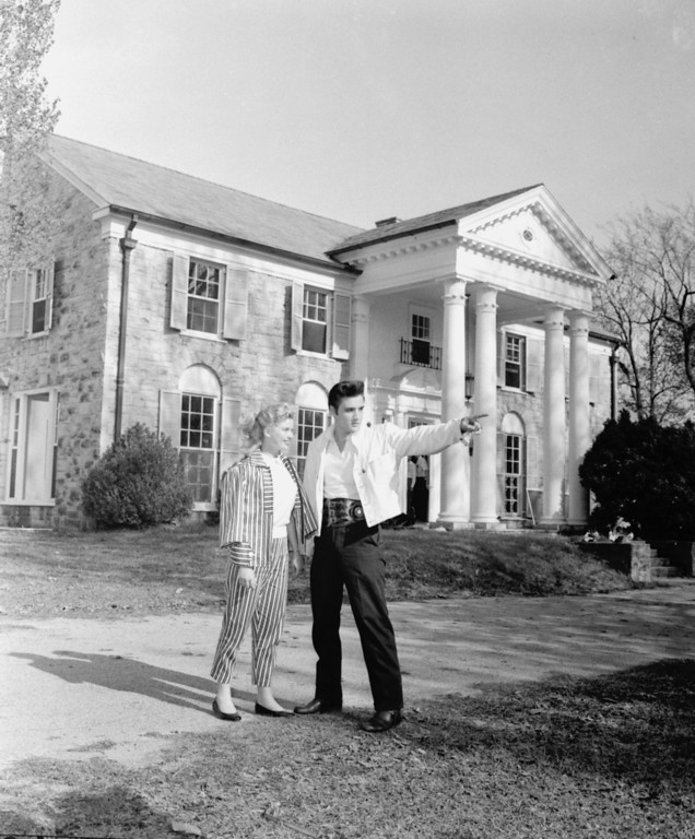 . Elvis Presley, the teenager\'s rock and roll idol, shows his new $100,000 home to Hollywood starlet Yvonne Lime, who flew in to spend Easter weekend with Presley and his parents, in Memphis, Tenn., April 19, 1957.   (AP Photo)