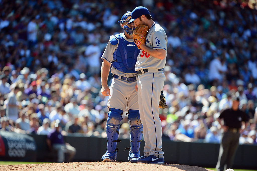. Catcher Tim Federowicz #18 talks with pitcher Matt Magill #36 of the Los Angeles Dodgers during the game against the Colorado Rockies at Coors Field on June 2, 2013 in Denver, Colorado. Rockies won 7-2.   Photo by Garrett W. Ellwood/Getty Images)