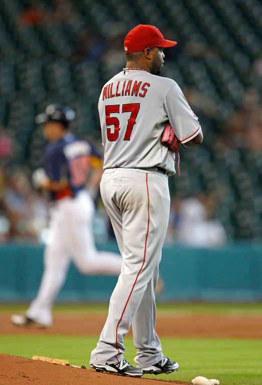 . Los Angeles Angels pitcher Jerome Williams walks off the mound as Houston Astros Marc Krauss rounds the bases after hitting a solo home run in the second inning of a baseball game Sunday, Sept. 15, 2013 at Minute Maid Park in Houston. (AP Photo/Eric Christian Smith)