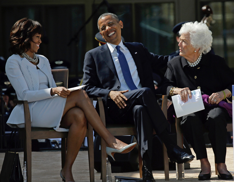 . President Barack Obama laughs as he sits between his wife, first lady Michelle Obama and former first lady Barbara Bush after his speech during the dedication of the George W. Bush Presidential Center, Thursday, April 25, 2013, in Dallas. (AP Photo/David J. Phillip)