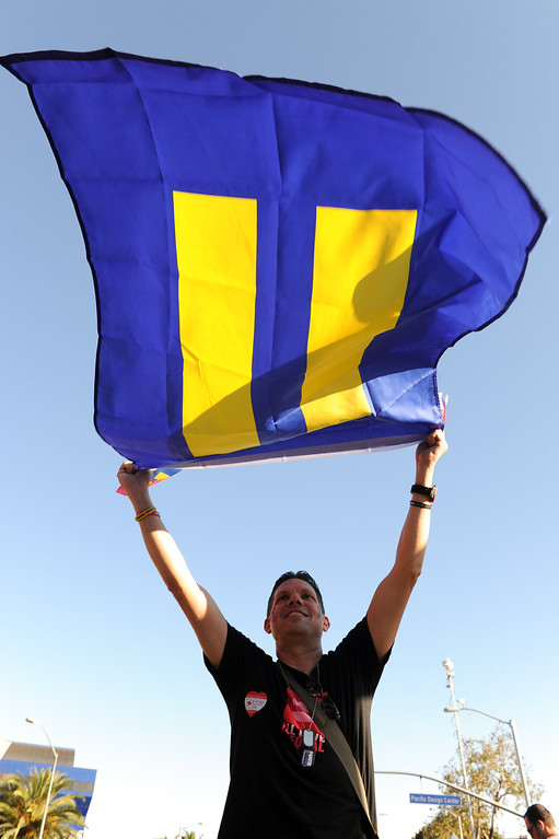 . Webster Slack waves an equality flag at the rally in West Hollywood to celebrate the U.S. Supreme Court\'s ruling that killed Prop 8, Wednesday, June 26, 2013. (Michael Owen Baker/L.A. Daily News)