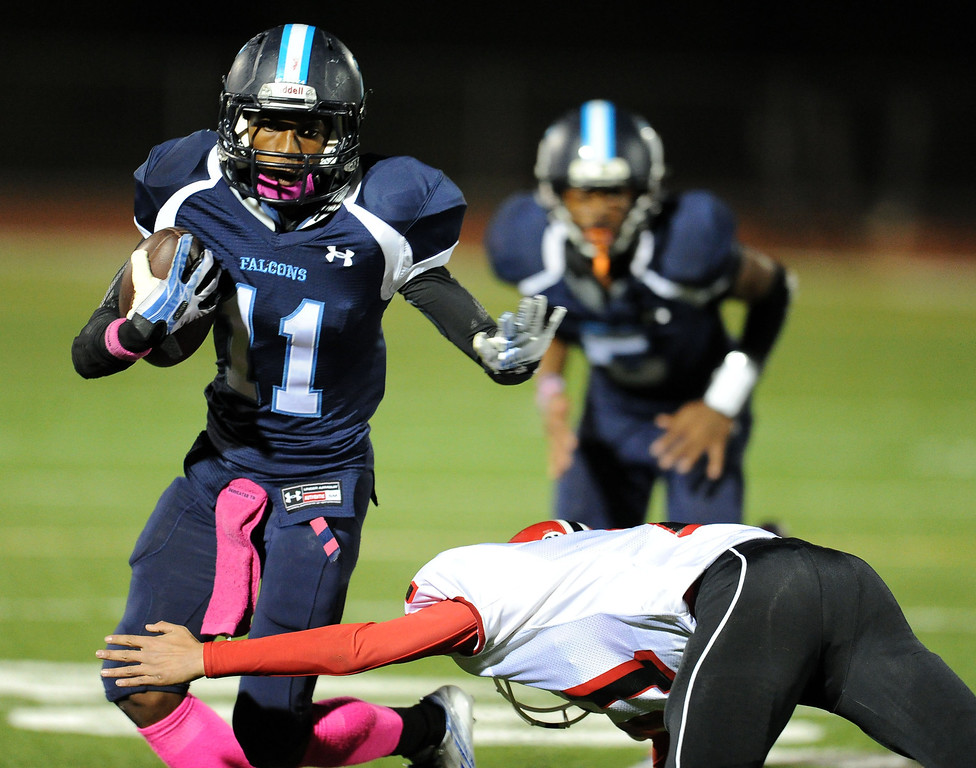 . Duarte\'s Devyn Washington (11) catches a pas for first down against Gladstone in the first half of a prep football game at Duarte High School in Duarte, Calif., Thursday, Oct. 10, 2013.    (Keith Birmingham Pasadena Star-News)