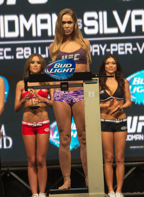 . UFC Woman\'s Bantamweight Champion Ronda Rousey weighs in at 135 lbs  at the MGM Grand in Las Vegas Friday, December 27, 2013. Rousey will be defending her belt during UFC 168, in a rematch against challenger Miesha Tate on Saturday at the MGM Grand Garden Arena. (Photo by Hans Gutknecht/Los Angeles Daily News)