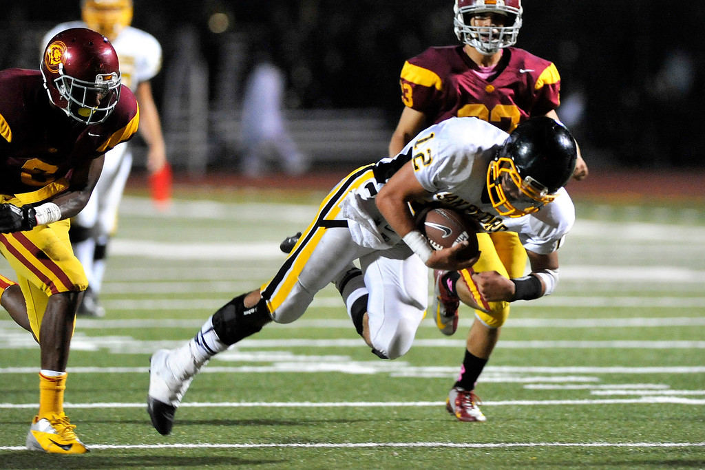 . LOS ANGELES - 10/04/2013 - (Mark Savage) San Pedro player Michael Hannifin makes a diving catch in the second quarter. Fairfax High School plays San Pedro High School at Fairfax High School.