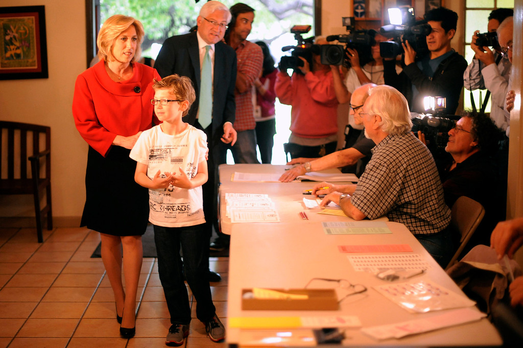 . Los Angeles mayoral candidate Wendy Greuel  casts her ballot at the Universalist Unitarian Church with her son Thomas Schramm Tuesday, May 21, 2013. (Hans Gutknecht/Los Angeles Daily News)
