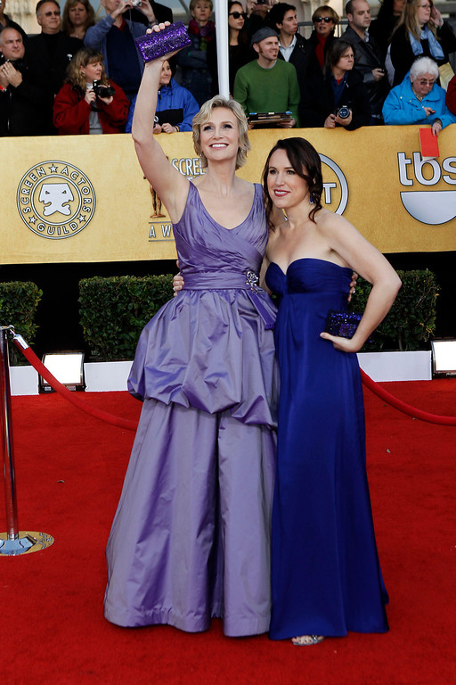 . Jane Lynch, left, and Lara Embry arrive at the 17th Annual Screen Actors Guild Awards on Sunday, Jan. 30, 2011 in Los Angeles. (AP Photo/Matt Sayles)
