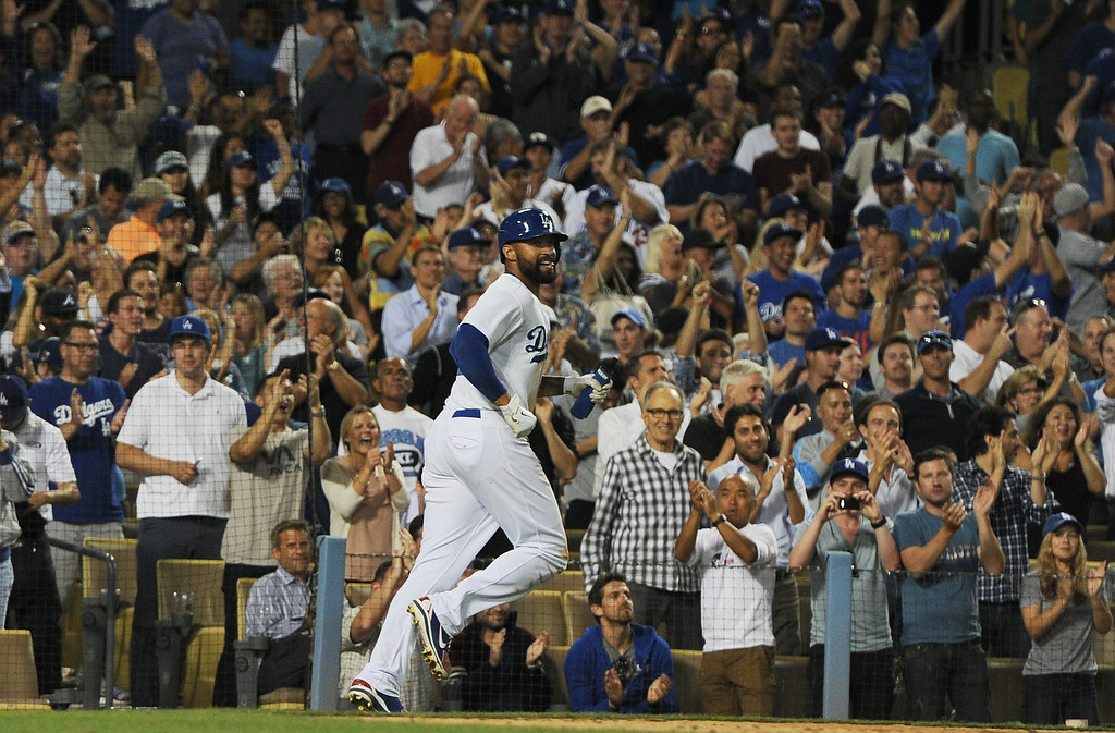 . The crowd reacts after Matt Kemp scored on a Juan Uribe single in the 8th inning. The Dodgers played host to the Atlanta Braves in a game played at Dodger Stadium in Los Angeles, CA. 7/30/2014(Photo by John McCoy Daily News)