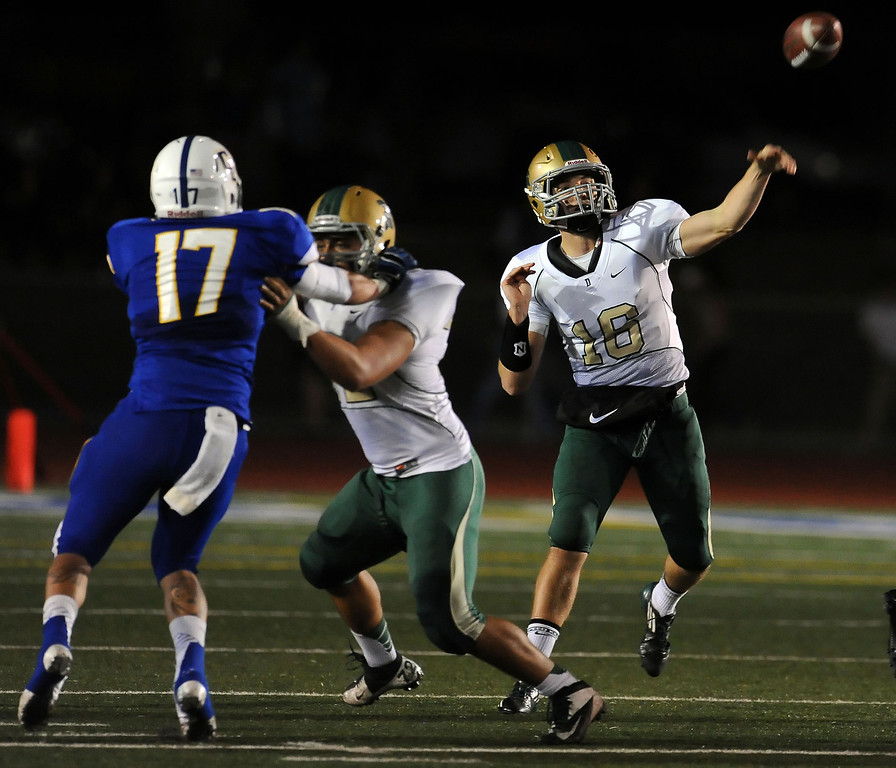 . Damien quarterback Brendan Callen (16) throws a interception to Charter Oak\'s Joshua Padilla (not pictured) in the first half of a prep football game at Charter Oak High School in Covina, Calif., Friday, Oct. 11, 2013.    (Keith Birmingham Pasadena Star-News)