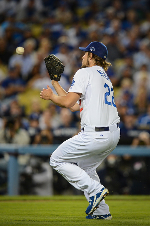 . Dodgers\' Clayton Kershaw fields a drive  game 4 against Atlanta  Monday, October 7, 2013 ( Photo by Hans Gutknecht/Los Angeles Daily News )