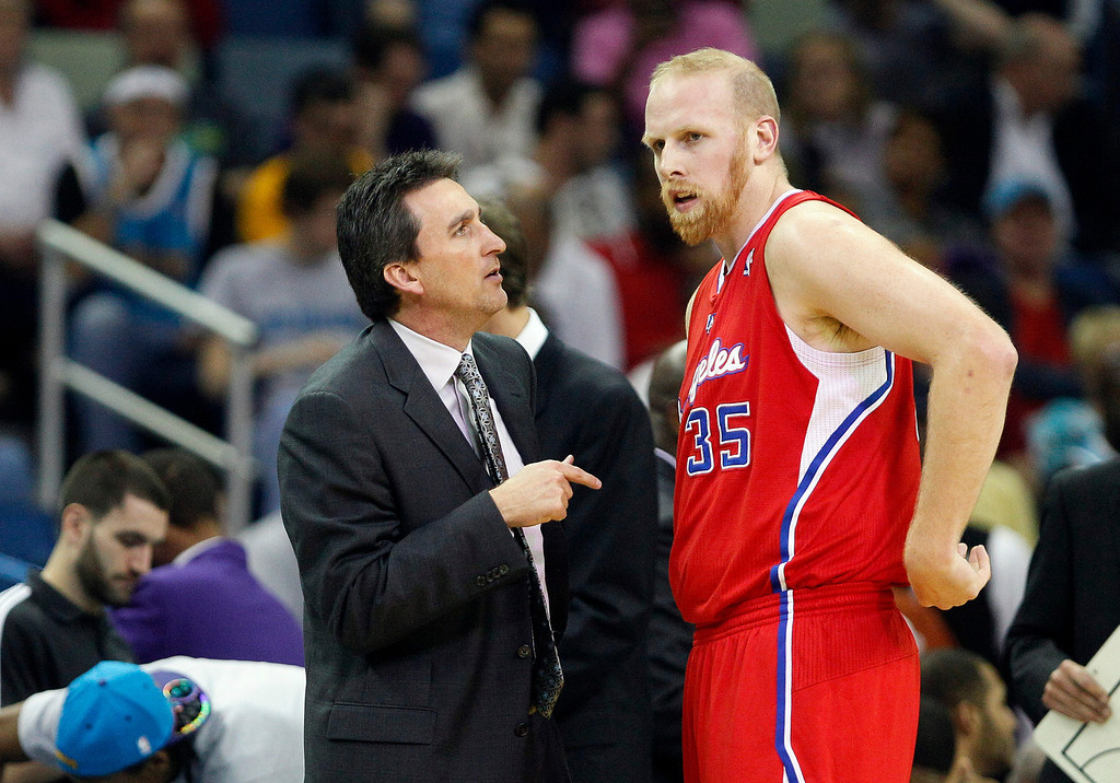 . Los Angeles Clippers head coach Vinny Del Negro, left, speaks with Clippers center Chris Kaman in the first half of an NBA basketball game against the New Orleans Hornets in New Orleans, Wednesday, Feb. 23, 2011. (AP Photo/Patrick Semansky)