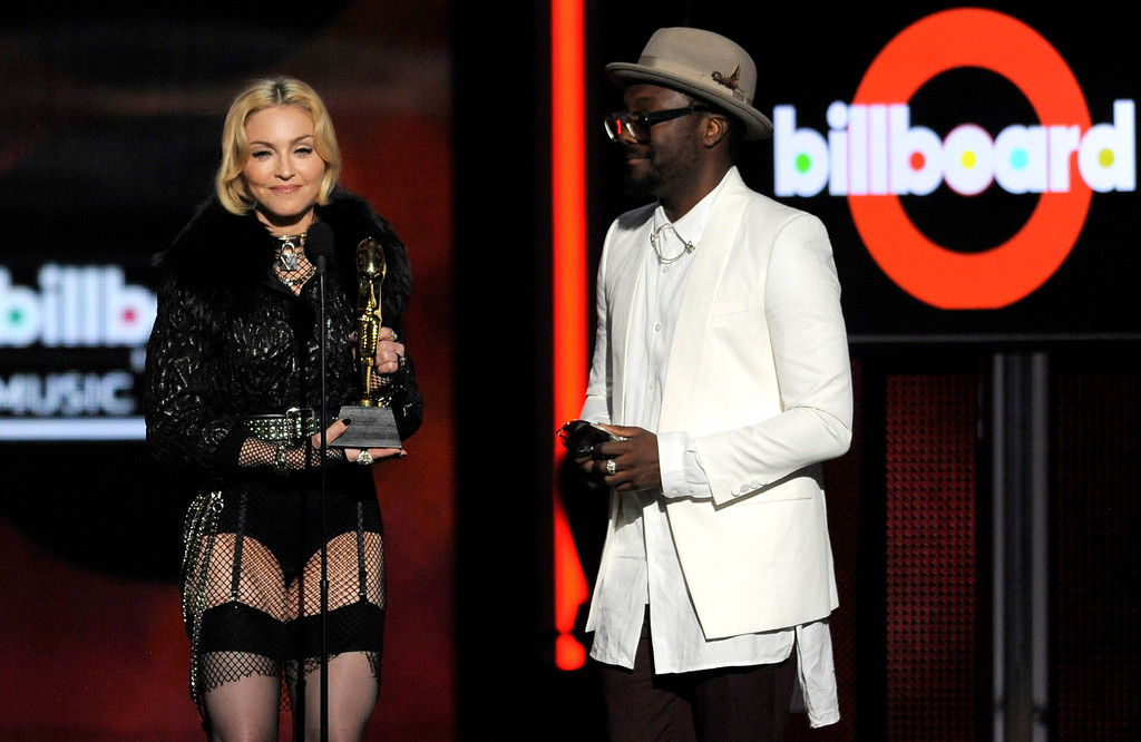 . Will.i.am, right, presents the award for top touring artist to Madonna at the Billboard Music Awards at the MGM Grand Garden Arena on Sunday, May 19, 2013 in Las Vegas. (Photo by Chris Pizzello/Invision/AP)