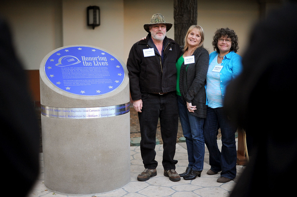 . Family members pose with the statue that was unveiled during a memorial ceremony for the 17 workers killed in the 1971 Sylmar tunnel blast Monday, December 9, 2013 in Los Angeles, CA.  A memorial statue was unveiled during the ceremony which took place at the Metropolitan Water District.  Brissette was the only miner who survived the water tunnel explosion.(Andy Holzman/Los Angeles Daily News)