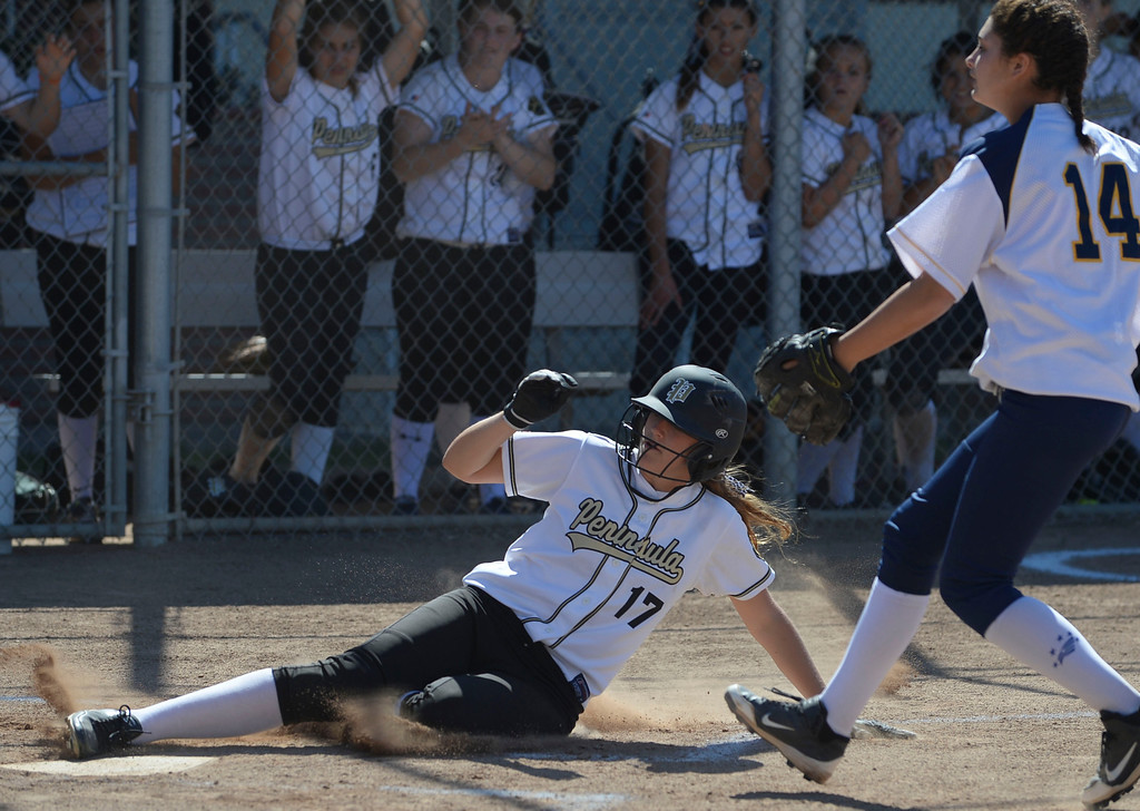. Peninsula\'s Katie Holcomb (17) adds another run as she slides home on a pitch that got away from Arroyo Grande in a CIF Southern Section Division III wild-card softball game in Rolling Hills Estates Tuesday. Peninsula won the game 13-0. 20130514 Photo by Steve McCrank / Staff Photographer